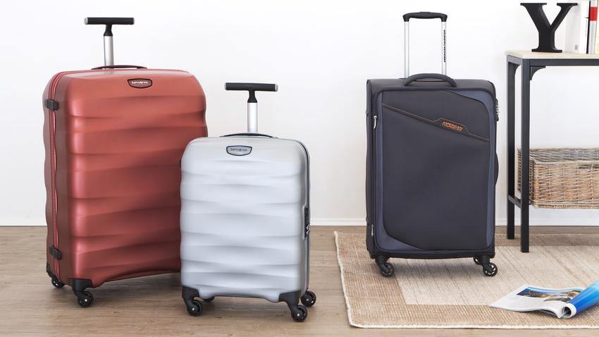 stříbrný skořepinový kufr