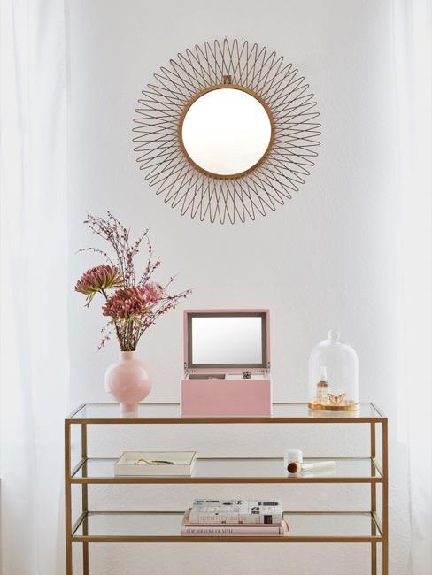 aparador con decoración y un espejo en forma de sol