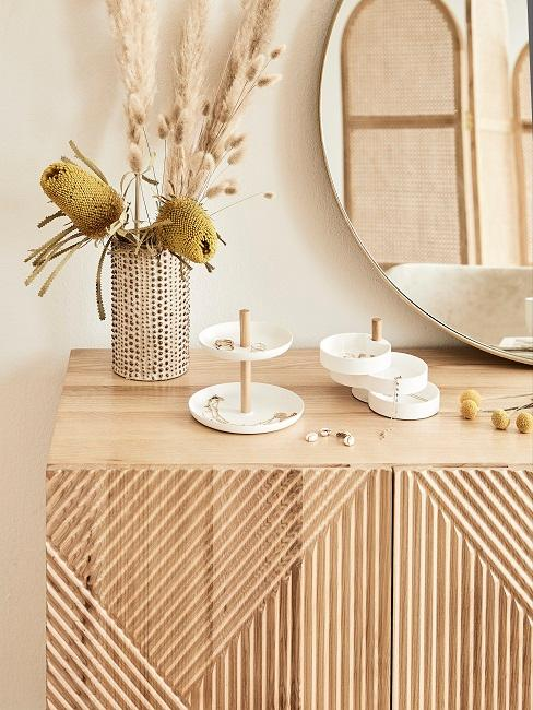 Etagere as jewelry storage on a sideboard in the bedroom