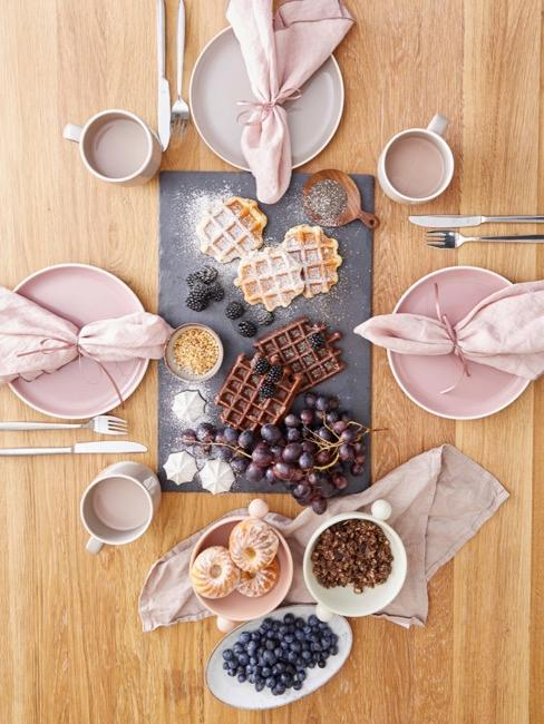 Dining table from above with various waffles on a granite top