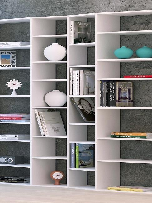 Decorate bookcase with vases and other decorative elements