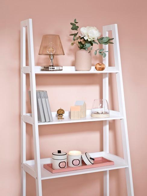 White ladder shelf with beautiful decoration in the living room.