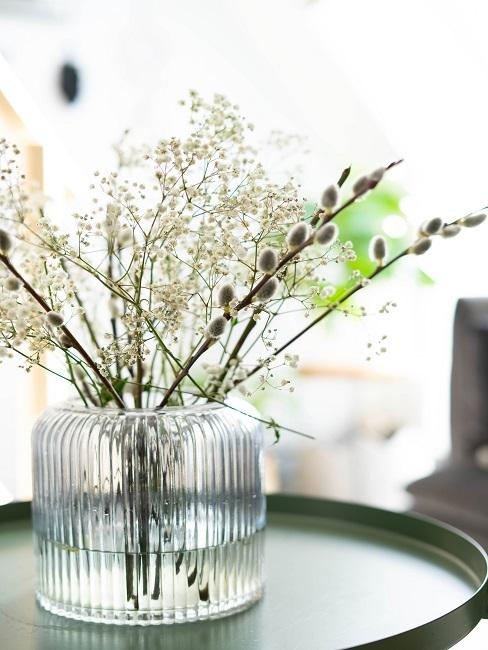 Baby's breath decoration with catkins in a large glass vase