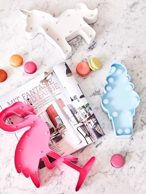 Flamingo shaped object lies on a marble shelf