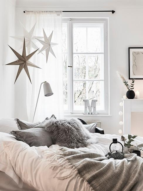 Decorative stars hang on the room ceiling in the living room