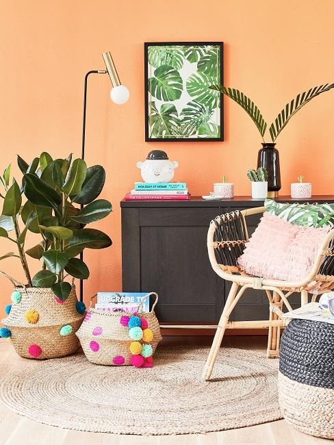 Baskets of colorful pompoms on the floor in the living area next to a black chest of drawers