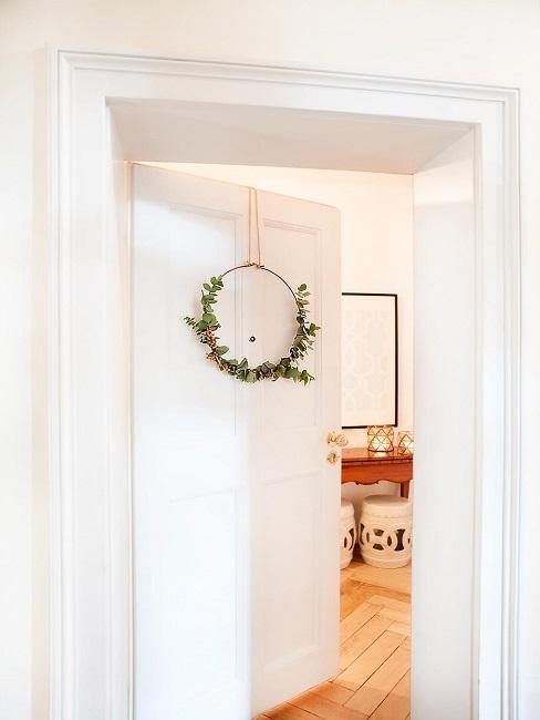 Metal ring decoration hangs on the front door.