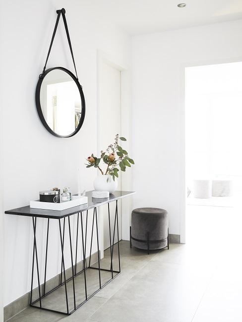 Luxus Wohnung einrichten Flur mir rundem Spiegel, Konsole und Hocker