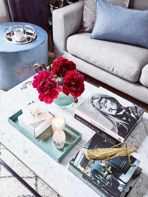 Coffee table books as decoration on a white marble coffee table