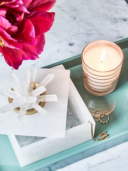 Decorative trays on a white marble coffee table