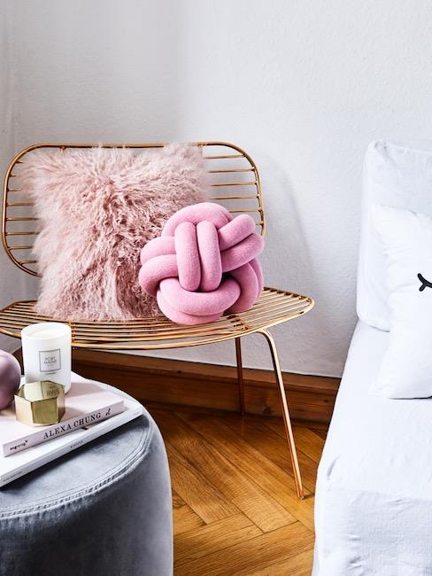 Pink knot pillow on golden chair