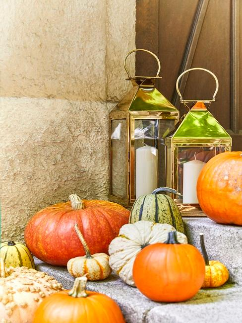 House entrance with pumpkin decoration and golden lanterns