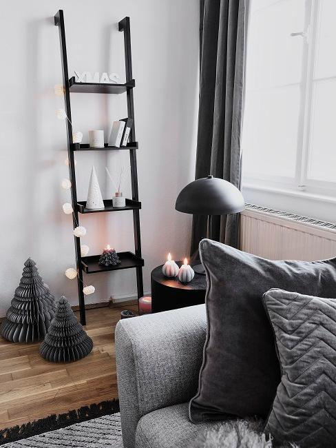 Black wooden ladder decorated for Christmas.