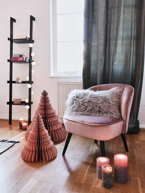 Wooden ladder decorated for Christmas with fairy lights and pink decorative objects.