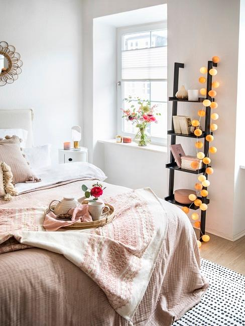 Wooden ladder in black with fairy lights with balls.