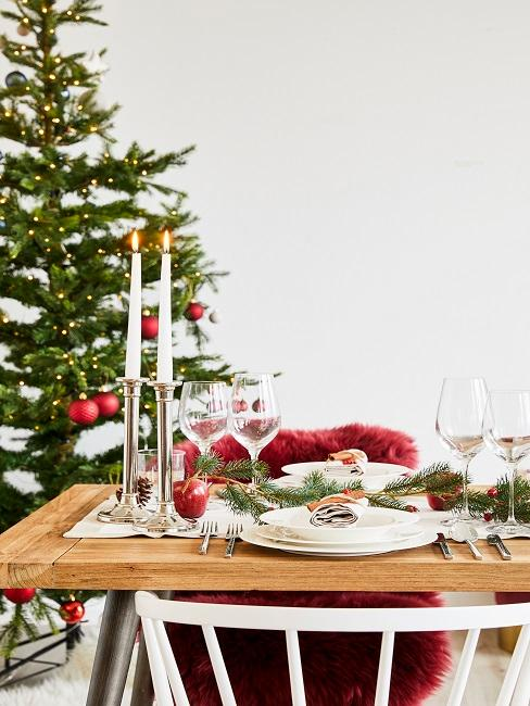 Dining table covered with winter decorations in the dining room.