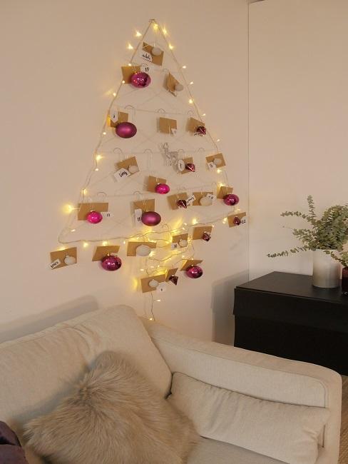 Advent calendar tree hangs on the wall.