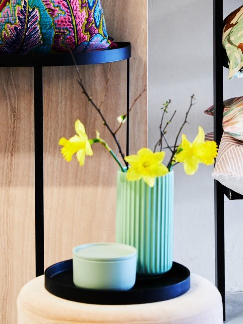 Yellow daffodils in a turquoise vase
