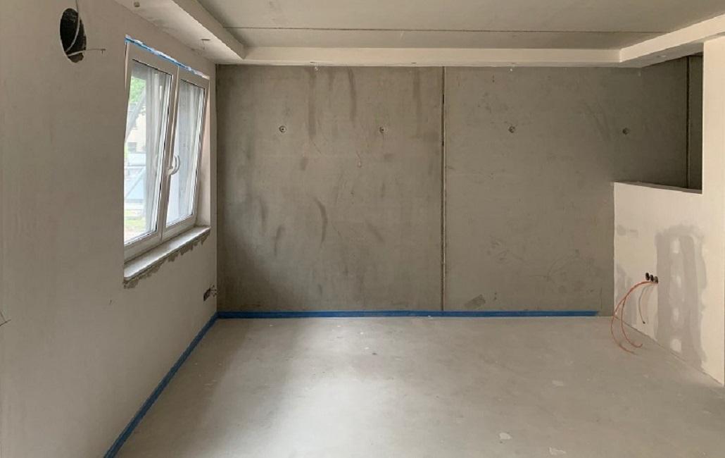Wohnzimmer mit offener Kueche einrichten vorher Rohbau 1