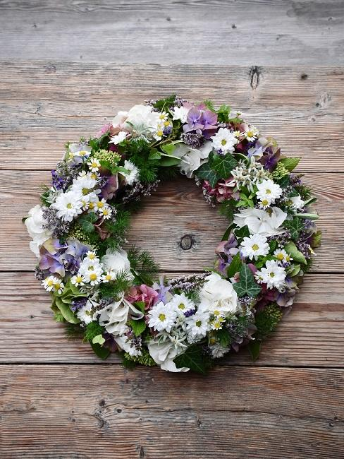 Flower wreath on wood