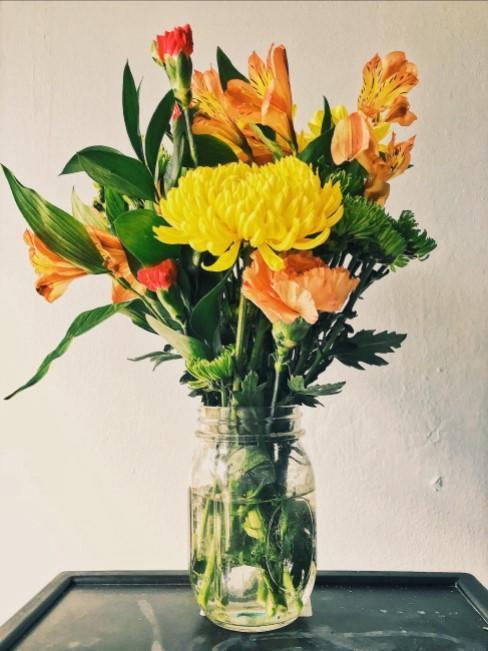 Blumenstrauß in Orange, Gelb und Grüne