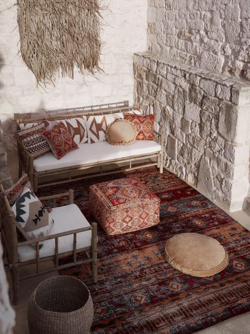 Terraza con tejidos en estilo boho