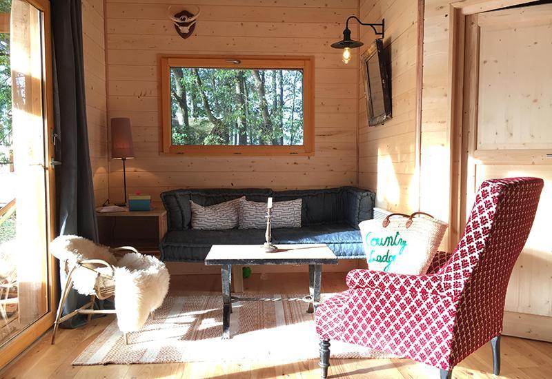Salon dans maison en bois Rencontre avec Arnaud Doin