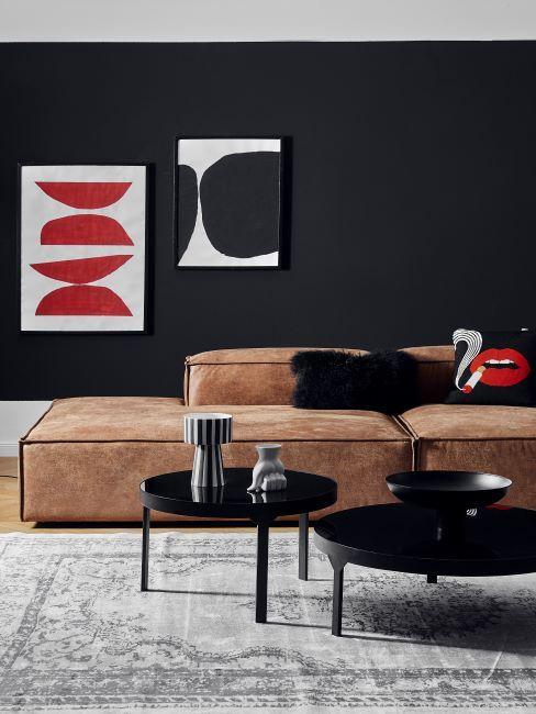 salon mur noir, peintures, tableau design, méridienne en cuir, table basse ronde