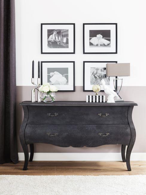 commode noir classique avec photos alignées noir et blanc