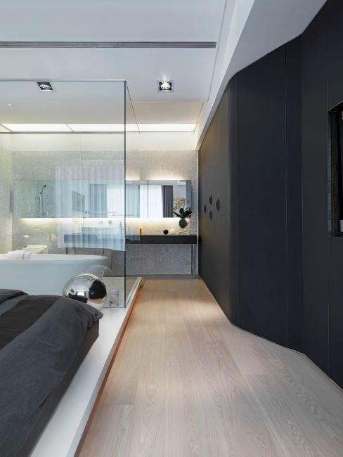 salle de bain en suite séparée par un mur en verre, intérieur moderne et minimaliste