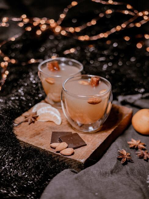 Een verwarmend drankje met gember op een houten bord