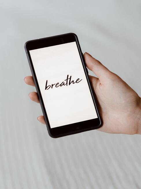 Mobiele telefoon met herinnering om te ademen