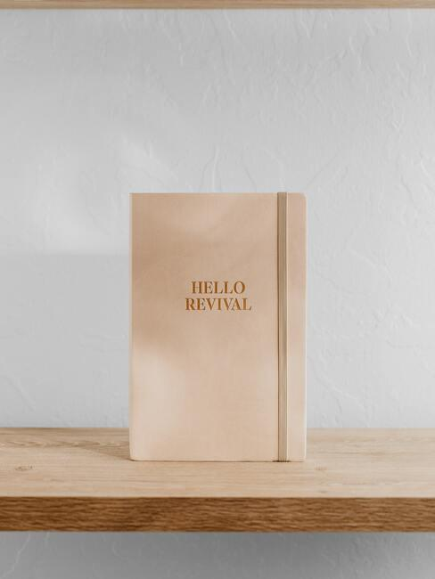 Notitieboek met de tekst: hello revival