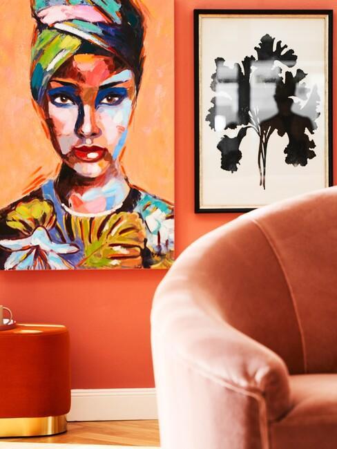 pop-art: oranje ronde bank met een gekleurd kunstwerk in een zwarte lijst