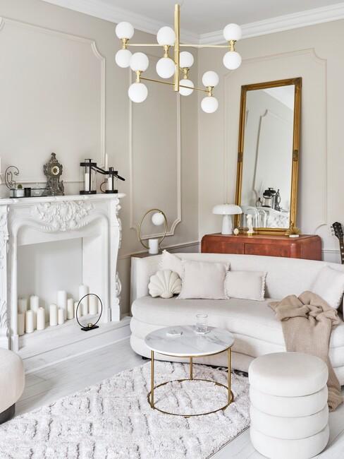Witte ronde bank in een beige kamer