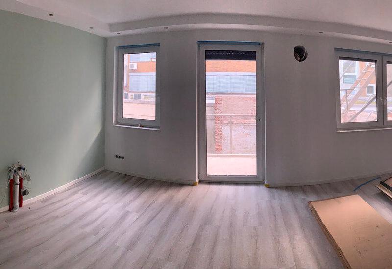 Kleine woonkamer met open keuken inrichten