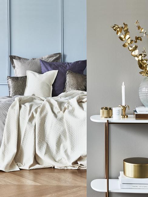 Blękitna sypialnia z szarymi tekstyliami oraz złotymi dekoracjami