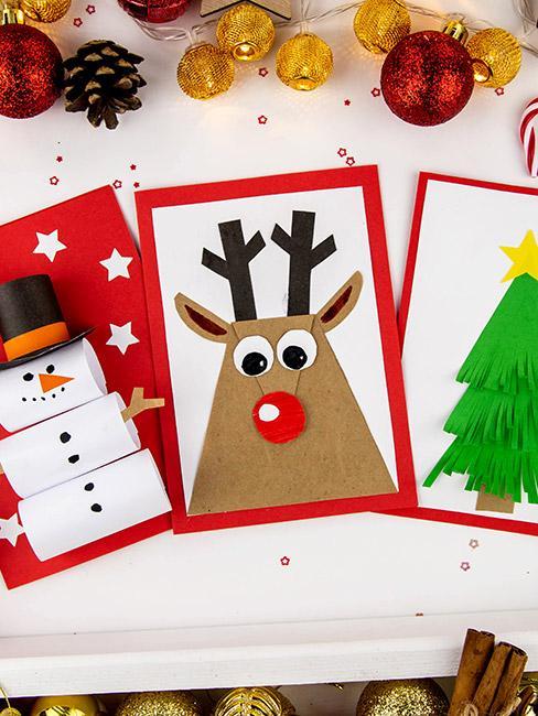 Trzy kartki świąteczne z bałwanem, choinką i reniferem