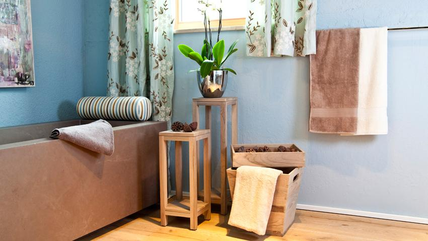 landelijke badkamer steen hout grijs bruin kleurrijk