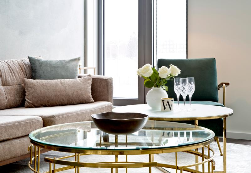 Ronde glazen salontafel met goud onderstel