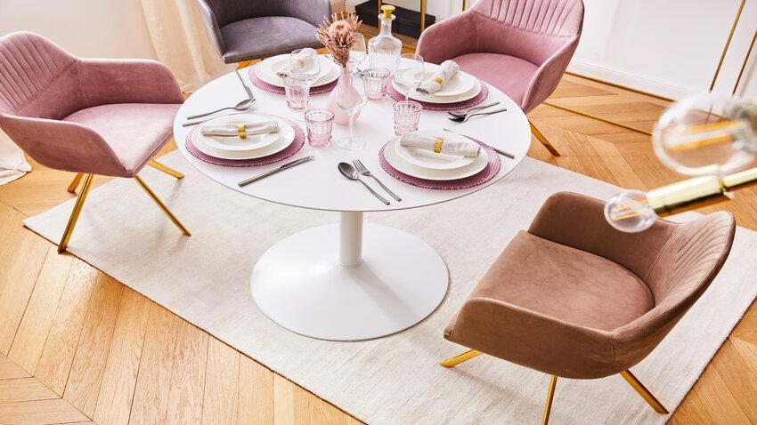 Biely okrúhly jedálenský stôl