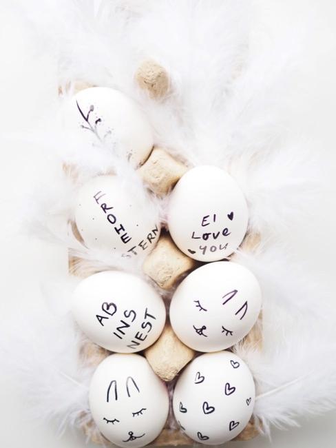 Ostereier mit handbemalten Sprüchen und Motiven