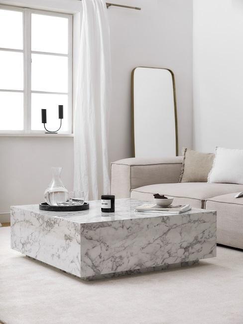 Hygge Wohnzimmer in creme mit Marmortisch und Couch