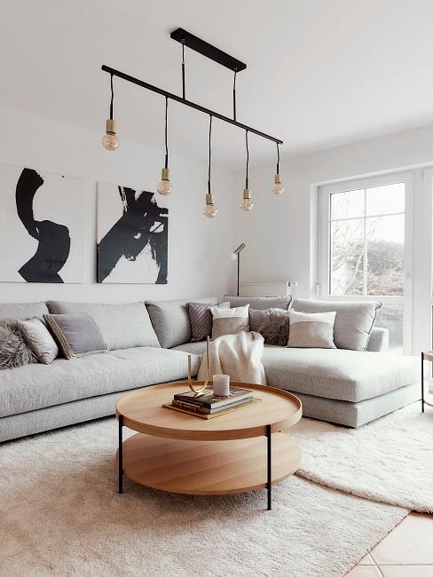 Großes Wohnzimmer einrichten Ecksofa Wandbilder