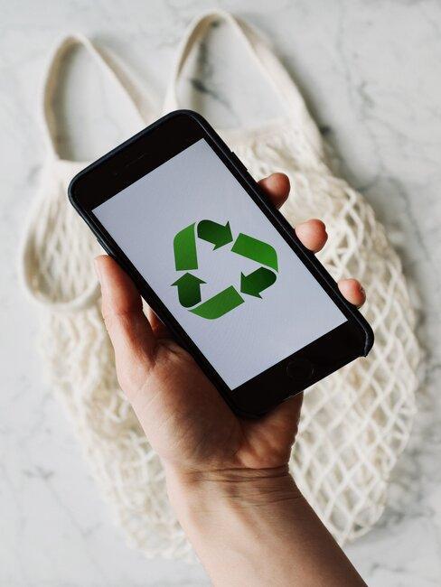 movil con simbolo de reciclar