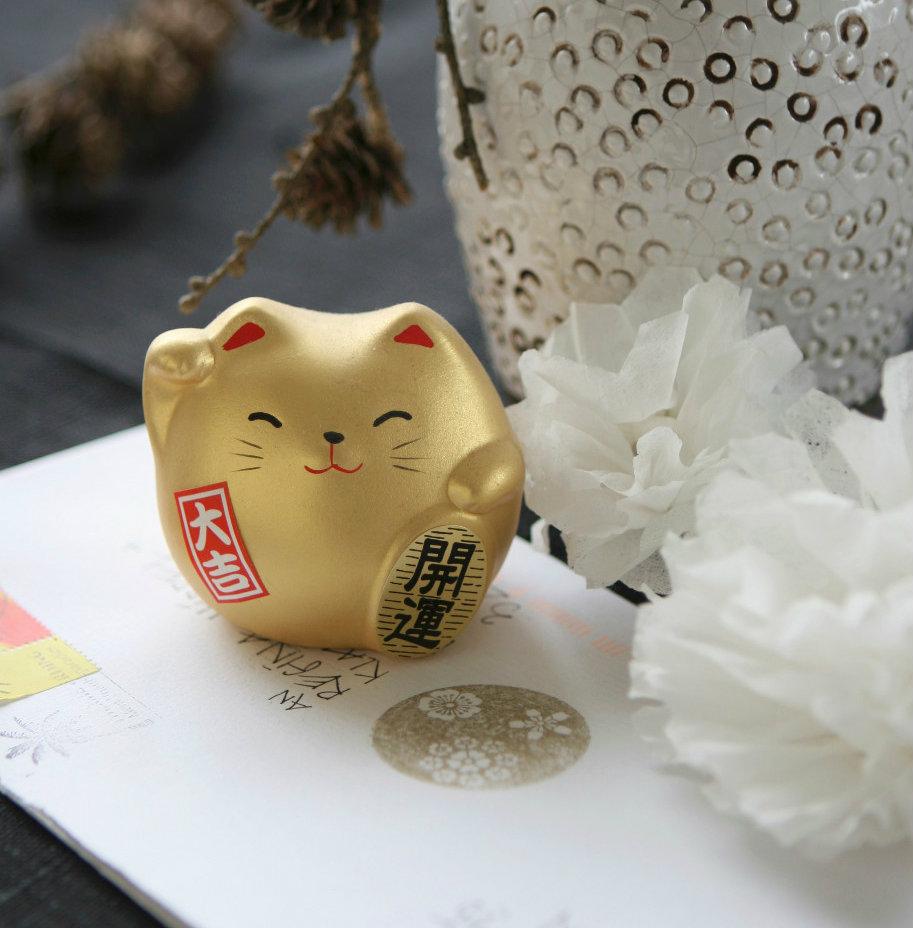 Amuletos japoneses maneki-neko