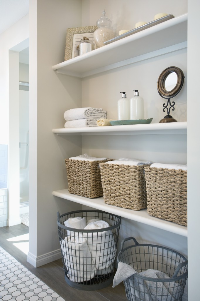Baskets and items on bathroom shelves