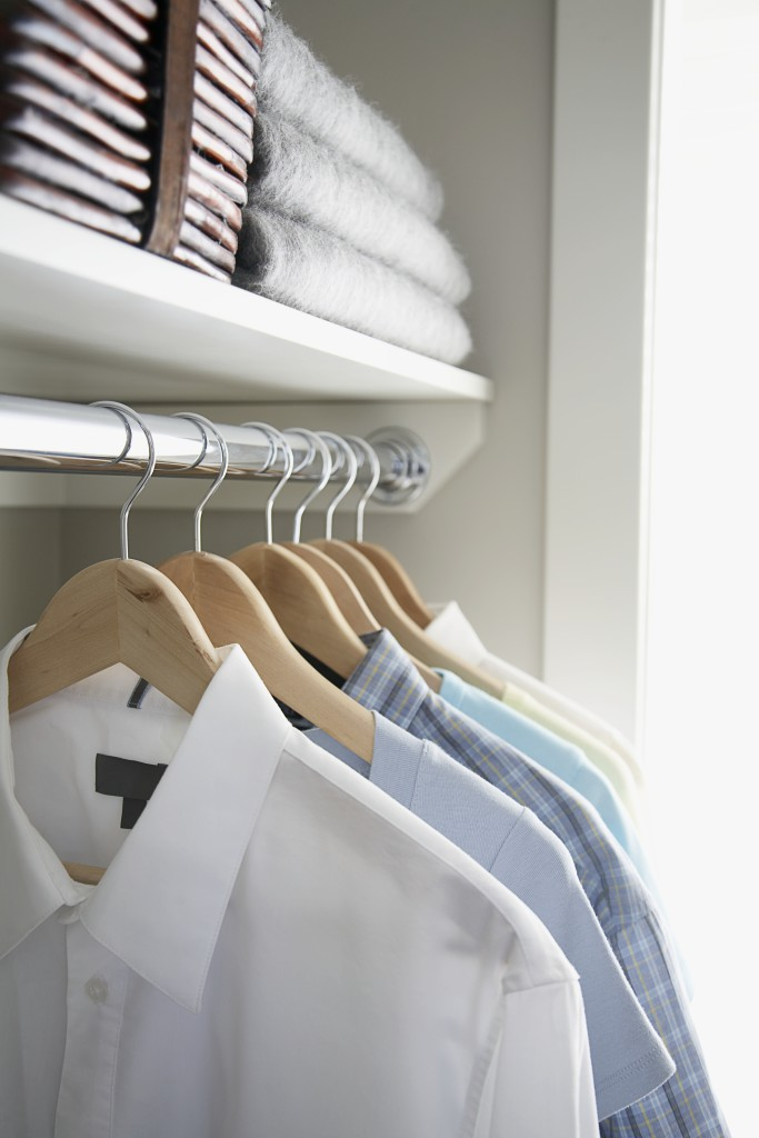 Shirts hanging in closet --- Image by © Kate Kunz/Corbis
