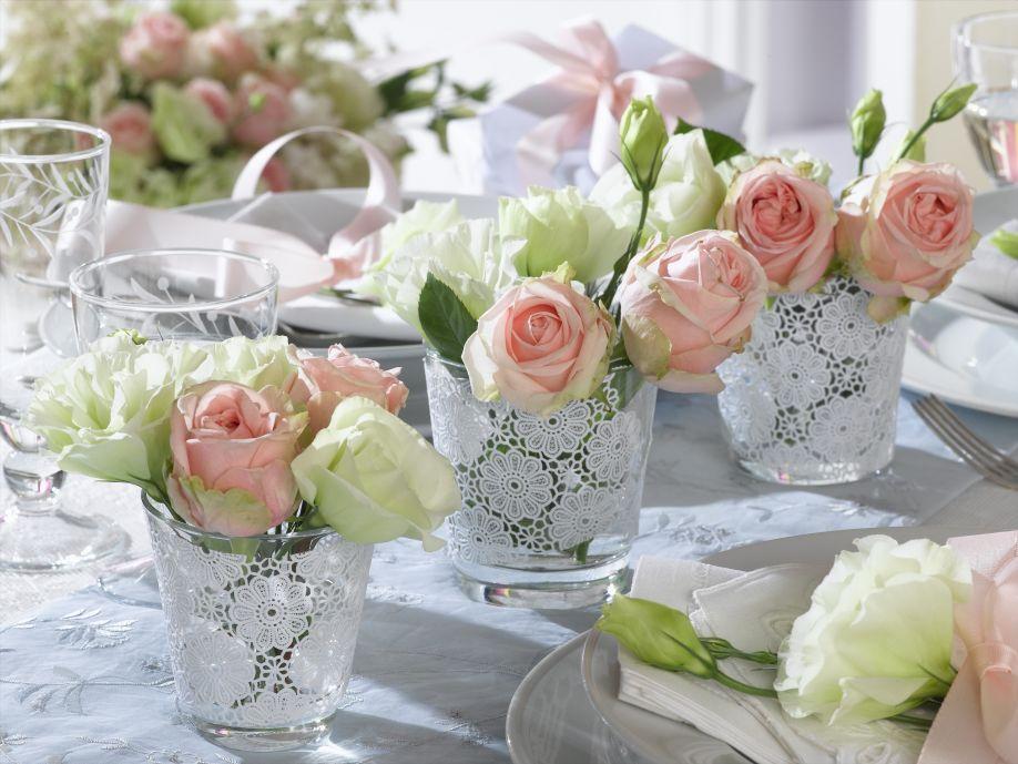 decoratie bruiloft tafeldecoratie roosjes in glazen